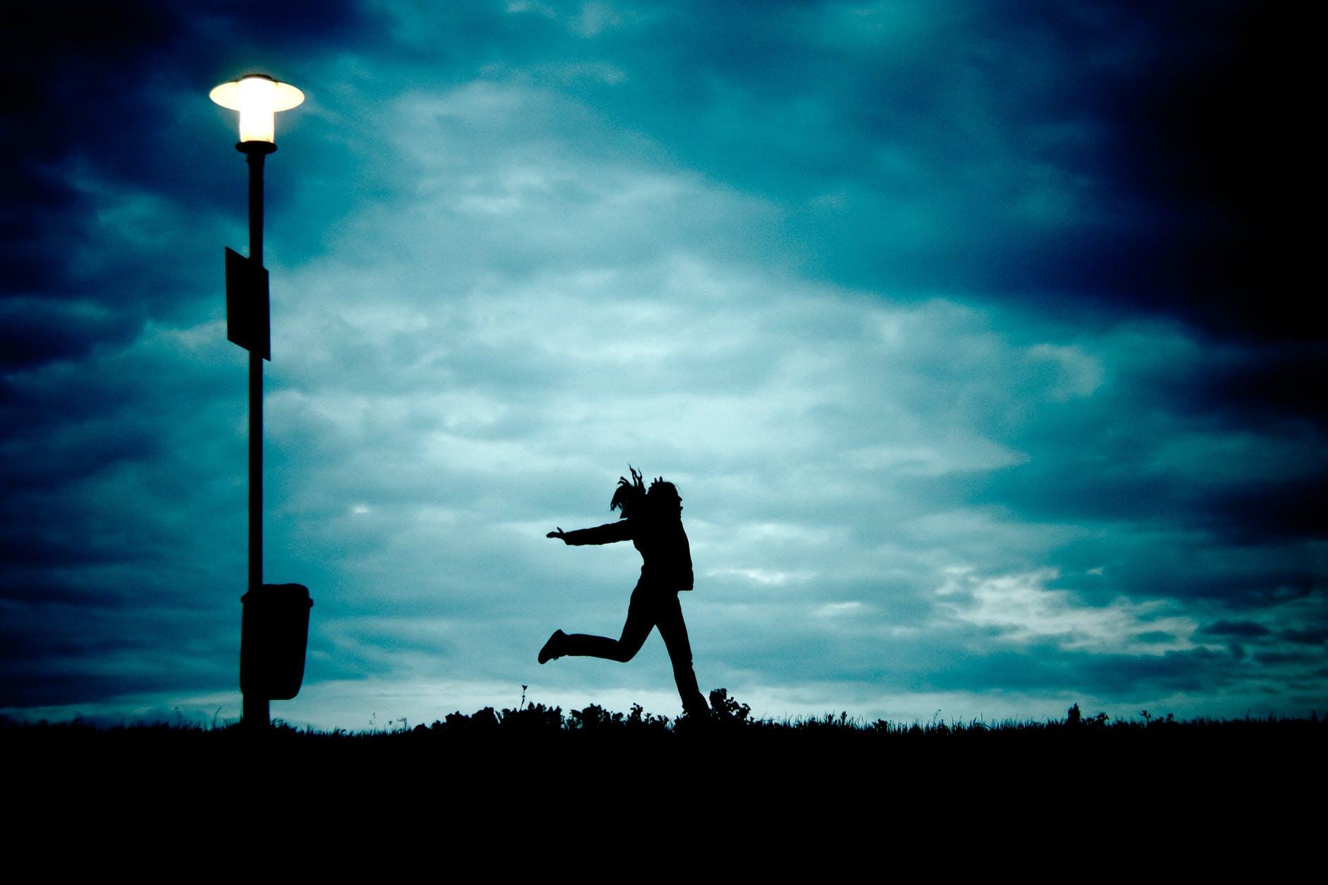 girl-at-night-running-cloud-68171.jpeg